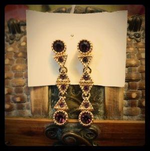 Signed Swarovski gold & amethyst earrings.